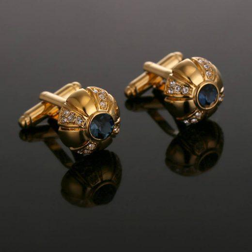 Luxusné manžetové gombíky v zlatej farbe s kryštálikmi a modrým kryštálom